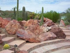 This outcropping between the stone steps blends in well with the natural plants as well as the rugged desert landscape in the background. Picture compliments of www.horticultureunlimited.com