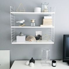 don 39 t let wall space be wasted space use shelving to create a media center around your. Black Bedroom Furniture Sets. Home Design Ideas