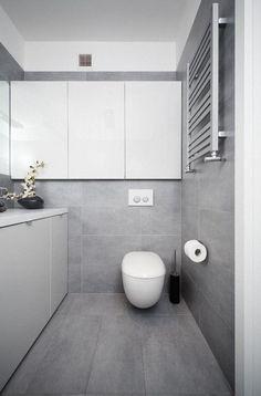 badezimmer modern einrichten graue fliesen weiße badmöbel grifflos
