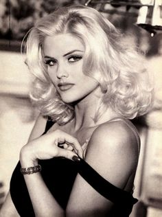 Anna Nicole Smith (Vickie Lynn Marshall) (November 28, 1967 – February 8, 2007), aka Vickie Smith, before settling on Anna Nicole Smith as her moniker, was an American model, actress and television personality. Smith first gained popularity in Playboy, becoming the 1993 Playmate of the Year. She modeled for clothing companies, including Guess jeans and Lane Bryant.