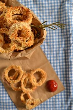 Simple baked onion rings flavored with fresh rosemary. Perfectly crunchy and satisfying onion rings with none of the guilt!