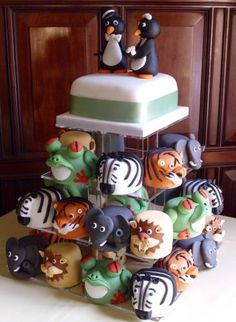 Penguin cake with detailed animal cupcakes