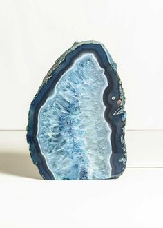 Large glowing natural stone agate geode lamp lights up and a pop of color. Includes bulb and cord with on/off switch to plug into any outlet (110v) for easy use. Perfect night light or reading lamp for nightstand or any table.