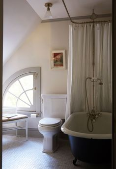 An Old-Fashioned Fixer-Upper That Was Untouched for Decades - Cool black and white bathroom