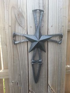 Check out this item in my Etsy shop https://www.etsy.com/listing/277893800/railroad-spike-cross-western-star-metal