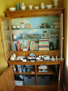 cabinet makeover - map background instead of paint! Use all the old National Geographic maps
