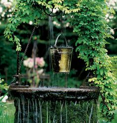 Your garden doesn't need to be laden with fabulous ancestral antiques -- just things you love. That said, a little restraint goes a long way, like this subtle bucket turned fountainhead.