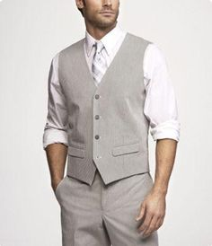 I would love for the groom and groomsmen to wear something relaxed like this. I don't want them in formal tuxes. Something like this on the beach? Hmmm