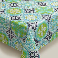 A sophisticated take on easy-care oilcloth, our tile design in green and blue is a summer-ready choice for indoors and out. www.worldmarket.com #CelebrateOutdoors