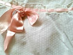 Vintage white cotton dotted Swiss bassinet cover for a newborn baby girl basket. This is for an oval shaped bassinet without the top hood. The cover is all one piece. The top area is meant to lay into the basket so the sides are fully covered. The outs...