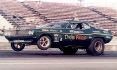 """When Tim Beebe returned to racing after the death of John Mulligan, he chose funny cars. Tim teamed with his brother Dave on the """"Dodge Fever"""" Cuda"""