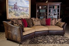 Fabric and leather combo sectional sofa.  Croc embossed leather on sides.  All pillows are included.  Western art. Living room at Brumbaugh's 817-244-9377
