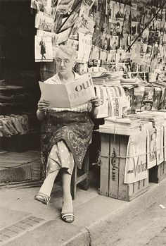 "books0977: "" Woman reading at newsstand, ""Ref. 105,"" Paris, 1958. Gérard Castello-Lopes (1925-2011). Courtesy Family Castello-Lopes, Paris. With a life divided between Portugal and France, he made his mark not only on cinema (both as a critic, actor,..."