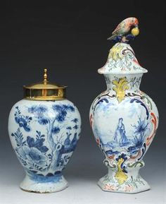 """A DELFTWARE BLUE AND WHITE POTTERY JAR of baluster form with later brass cover, decorated in the Chinese style, 18th Century and a Delft polychrome baluster vase and cover with parrot finial, 10 1/2"""" (2)"""