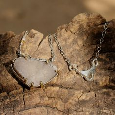 Druzy triangle shaped pendant necklace in silver setting with brass accent prongs Check more at