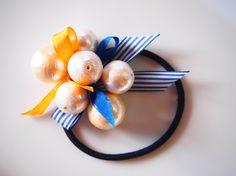大粒のコットンパールと シルクリボンをランダムに合わせたヘアアクセサリー コットンパールのたわたわ感が可愛い(^^♪ネイビー&オレンジがキュートな印象...|ハンドメイド、手作り、手仕事品の通販・販売・購入ならCreema。