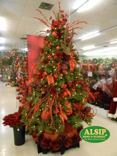 "#4 This ""Julie"" tree is all about red! A great monochromatic theme with rustic elements."