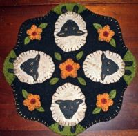 Meadow sheep penny rug.  I want to do this for a friend.