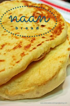 If you have yet to enjoy this delightful flat bread, give this Indian Naan Bread Recipe a try! Our family has so much fun using this fluffy bread to sop up their plates no matter what we make to go with it. DelectableCookingandBaking.com   #IndianNaanBread #flatbread #yeastbread #friedbread