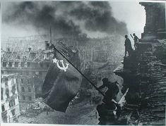 "World War II: The Fall of   Nazi Germany  ""Raising a flag over the Reichstag"" the famous photograph by Yevgeny Khaldei, taken on May 2, 1945. The photo shows Soviet soldiers raising the flag of the Soviet Union on top of the German Reichstag building following the Battle of Berlin."