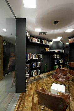 I think this is another cool angle. Again, I would replace the bookshelf with the wood wall installation (Tristan Auer) for the purpose of a backdrop. Love those chairs. Cool lighting.