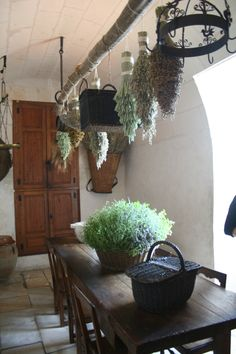 hanging dried herbs or lavendar in kitchen window--should dry in dark as light bleaches nutrients--nice diy drying pole.