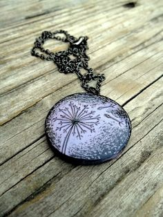 Pendant created in a black polymer clay with lavender acrylic paint.