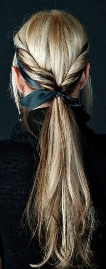 This is a pretty standard rolled ponytail, but a ribbon headband threaded under and then tied around jazzes it up a little