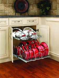 Rev-A-Shelf 5CW2-2122-CR Cookware Organizer, one of our most popular items. This forces you and your family to keep the pots and pans in the right place, no more dis-organization creep. How do you keep your pots and pans organized? we love good ideas to share. View all at http://www.ovisonline.com/Cookware-Organizers-C90.aspx