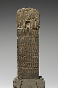 Stele Commissioned by Li Zhewang, Yao Langzi, and Other Members of a Devotional Society  Period:     Northern Wei dynasty (386–534) Date:     dated 528 Culture:     China Medium:     Limestone with traces of pigmen