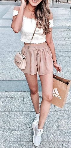 what to wear with a pair of sneakers : white top   bag   blush shorts