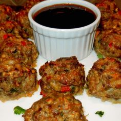 Jamaican Jerk Meatballs Recipe Appetizers, Main Dishes with onions, red pepper, olive oil, garlic, pork, ground beef, panko breadcrumbs, large eggs, milk, pineapple juice, chopped cilantro, lime juice, worcestershire sauce, jamaican jerk seasoning, salt, black pepper, dipping sauce, marinade