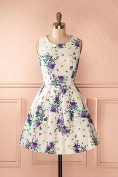 Elle épingla à la corde à linge ses poèmes printaniers. She pinned on the clothesline her spring poems. White and violet floral print a-line dress www.1861.ca