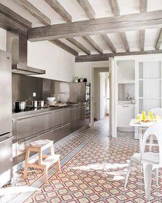 statement tile floor, natural wood beams, modern kitchen