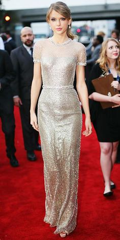 Taylor Swift's glittering Gucci gown is easily one of our favorites from the 2014 Grammys red carpet! See more gorgeous gowns here: http://ow.ly/sY7zR