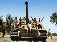 #WW2ColourisedPhotos ......   Members of the 22nd New Zealand Motor Battalion, on a captured German Panzer VI 'Tiger' tank of the sPz.Abt.508, in the village of La Romola, Italy, on the 2nd of August 1944.  The village of La Romola was defended on the night of July 30/31st by elements of the I/Bn. Grenadier-Regiment 15 (mot) and a few 'Tiger' tanks of 3./Panzer-Abteilung 508, one of which was knocked out (or broke down) during the battles.