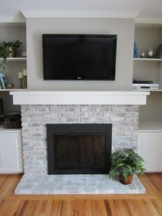 White-washing brick fireplace – Home Staging In Bloomington Illinois White Wash Brick Fireplace, Painted Brick Fireplaces, Fireplace Doors, Fireplace Update, Brick Fireplace Makeover, Home Fireplace, Fireplace Design, Fireplace Ideas, Fireplace Whitewash