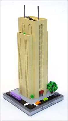 Magnus built a simplified art deco skyscraper. The building does however use some cool techniques with the arch and grille tiles.
