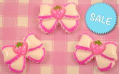 These cute white ribbon bows with strawberry resin Flat Back cabochons. These #kawaii style #cabochons are perfect for all kinds of crafts. #JewelryCraft