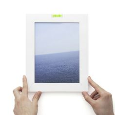 A picture frame with a built-in spirit level ... but that puts the picture inside at an angle = OCD hell. Inbolla by Odoardo Fioravanti