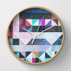 Who doesn't love a great geometric print? Check the time with this modern and colourful clock that is sure to spice up those plain dorm walls!