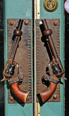 Wild West Six-Shooter door handles. Door to the man cave! Door Knobs And Knockers, Knobs And Handles, Door Handles, Door Pulls, Burger Bar, My Pool, Unique Doors, The Doors, Door Furniture