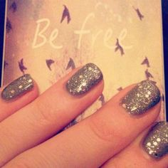 Created by Oxley's Blue Fish Spas, adding a bit if sparkle to 2014! Jessica Nails GELeration Monarch with Silver Sparkler.