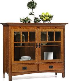 The two wide glass doors on the Desert Hills China Pantry have mullions that give this piece a Mission style that goes perfectly with the inlays and mission style hardware. Furniture Risers, Oak Bedroom Furniture, Farmhouse Living Room Furniture, Hardwood Furniture, Amish Furniture, Primitive Furniture, Furniture Styles, Fine Furniture, Rustic Furniture