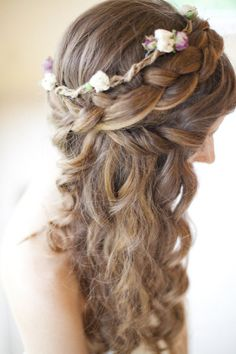 braided hair with tight waves and flower accents