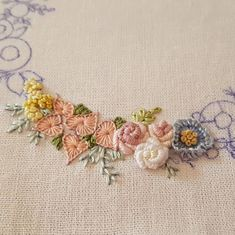 embroidery WIP with bullion roses and chain stitch leaves