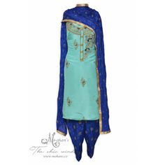 Elegant azure unstitched suit adorn in delicate hand work-Mohan's the chic window