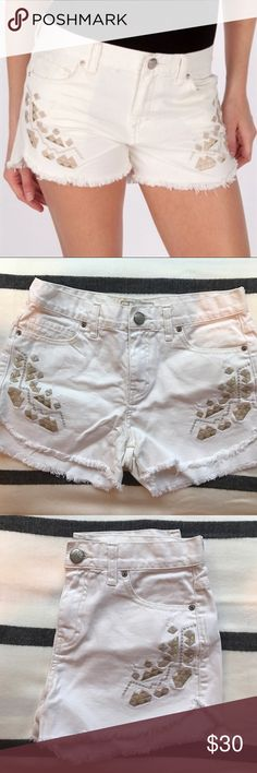 """Free People Sz 26 Embroidered Denim Shorts High waisted Free People Sz 4 white denim jean shorts Embroidered with Aztec/Geometric pattern and gold metallic detail. Distressed look ok pant pockets and bottom fraying on shorts. No flaws. Measurements: across the top 14"""", rise: 9"""", inseam 2.5"""".  100% cotton. Machine wash cold. Free People Shorts Jean Shorts"""