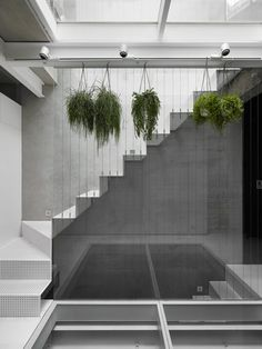 KC Design Studio adds perforated facade and atrium to skinny Taiwanese townhouse