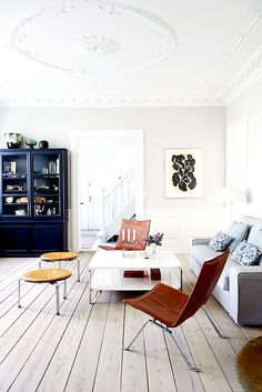 Just as Scandinavians look to the landscape to inspire their choice of colours, they do they same with materials. You'll find worn wood floorboards and buttery soft leather chairs in almost every...